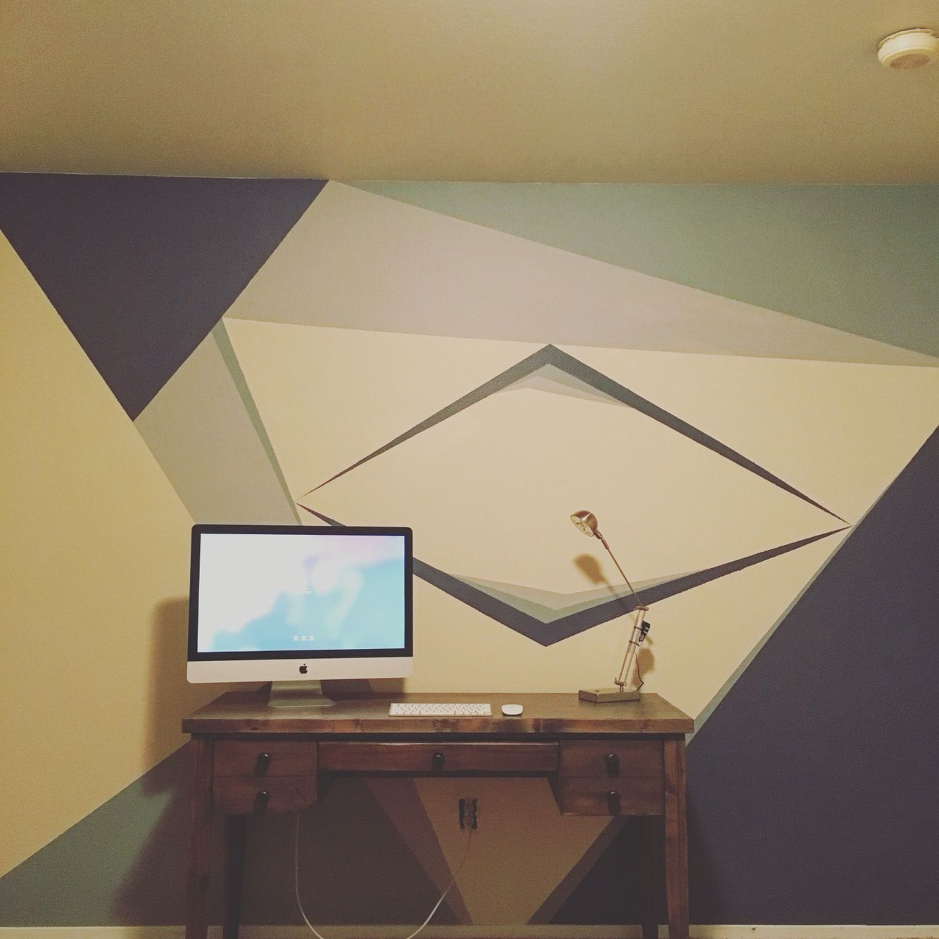Cool DIY geometric accent wall I created for my bedroom!
