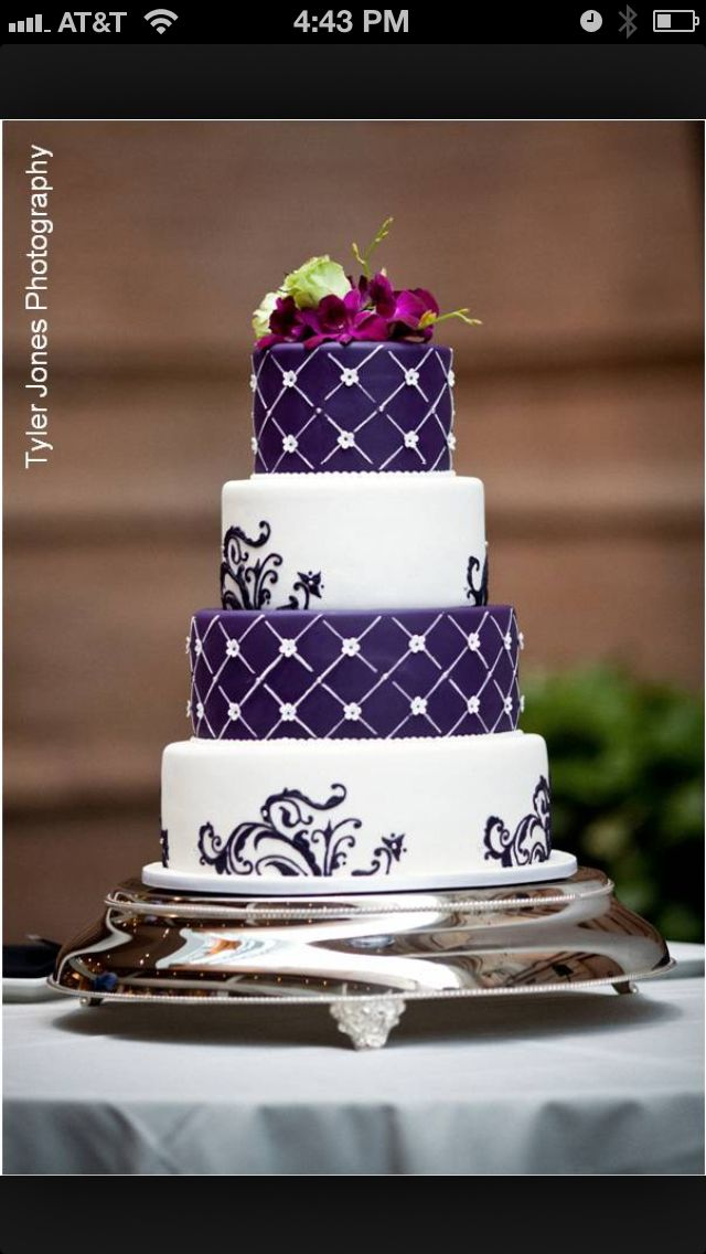This could be a simple way to do our wedding cake to keep the cost down, except with black, white, and sapphire, and with working in our triangle with a circle in the center