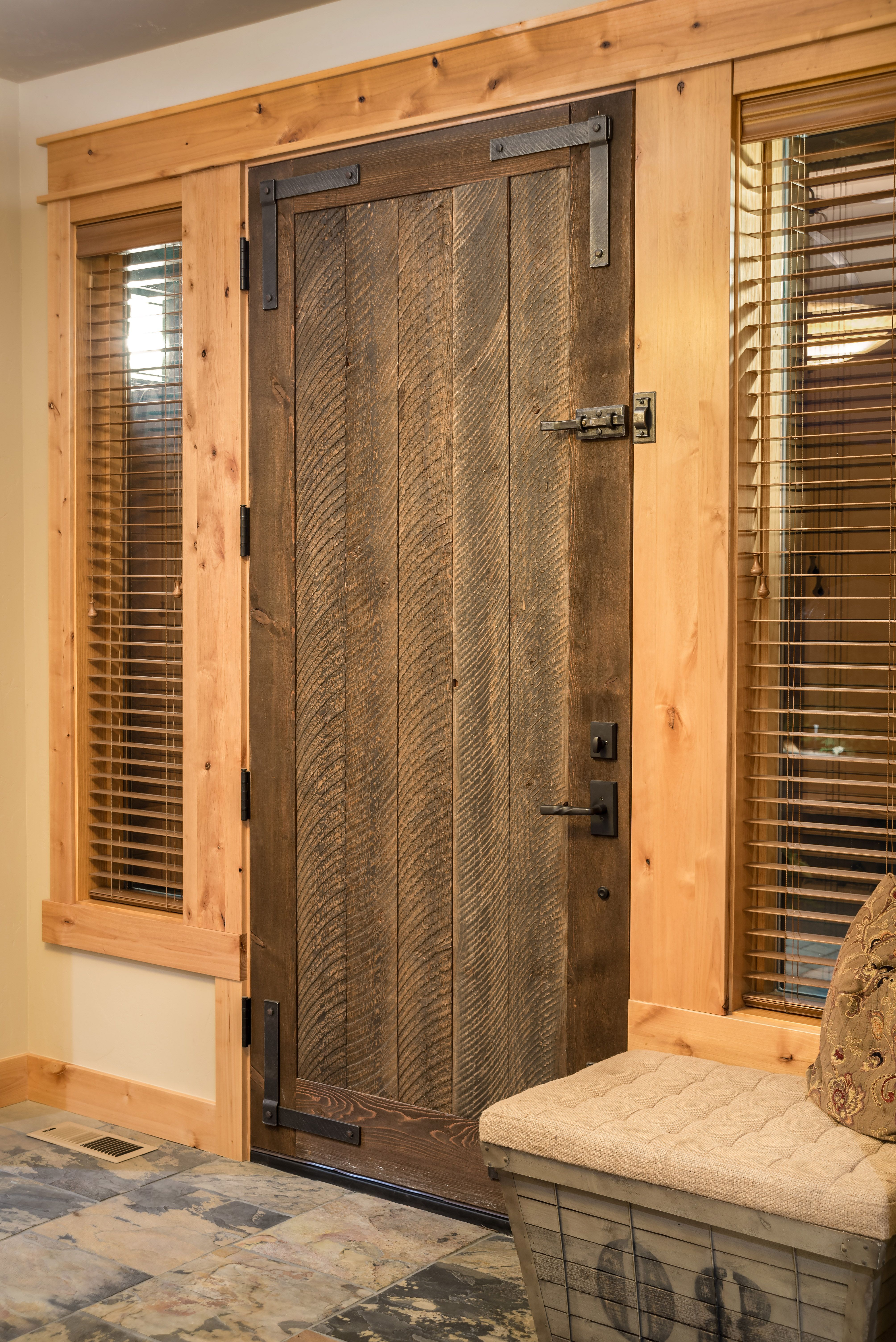 A rustic and well crafted front door gives the home distinct personality. & A rustic and well crafted front door gives the home distinct ... pezcame.com