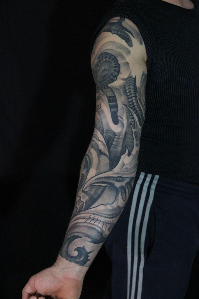 25 Amazing Biomechanical Tattoos Design Biomechanical Tattoo Biomechanical Tattoo Design Sun Tattoo Designs