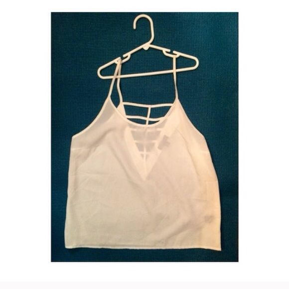 White tank top Like new. Chiffon type material. Cut out backing. Tops Tank Tops