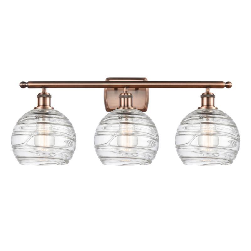 "Photo of Innovations lighting 516-3W Deco Swirl Deco Swirl 3 Light 26 ""Wide bathroom Vani Antique copper / Clear interior lighting Vanity Light bathroom fittings"