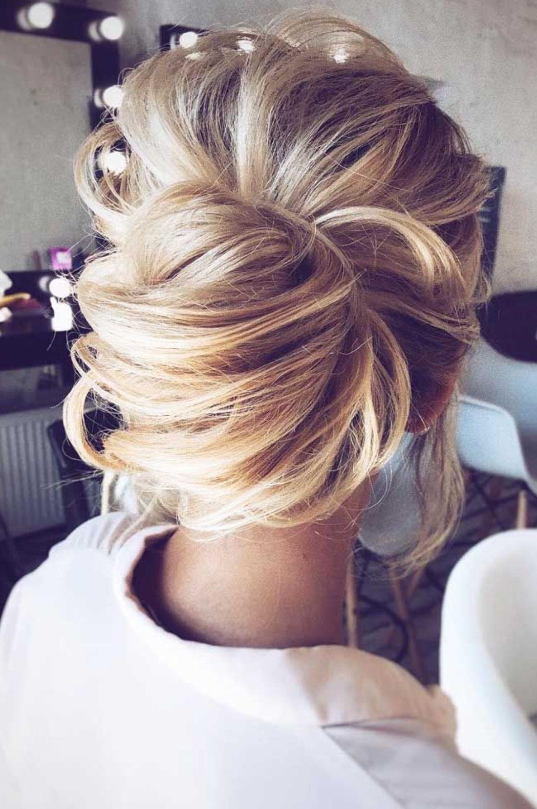 Modern day chignonstyle low messy bun updo beautiful