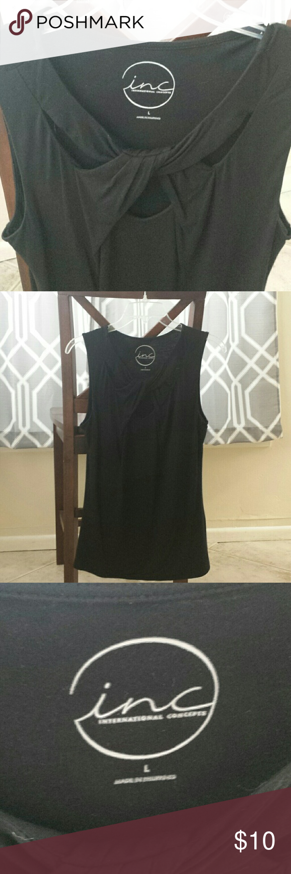 Black stretchy top with cross front detail Dark black and in good condition. long and stretchy with a criss cross detail. Very cute. INC International Concepts Tops