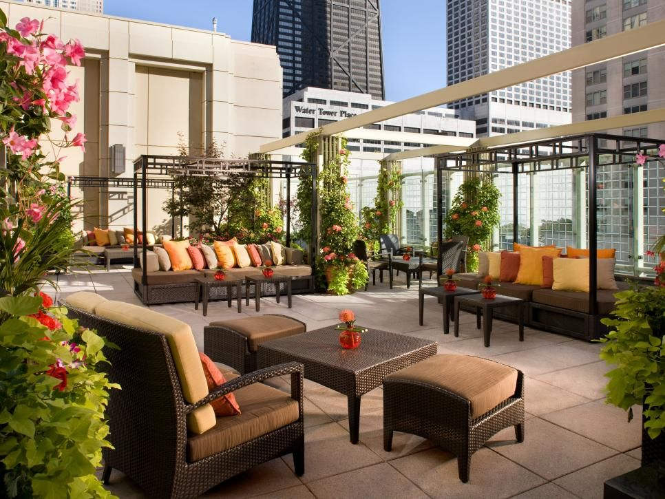 Outdoor Lounging Spaces Daybeds Hammocks Canopies And More Hgtv Outdoor Rooms Terrace Design Roof Terrace Design