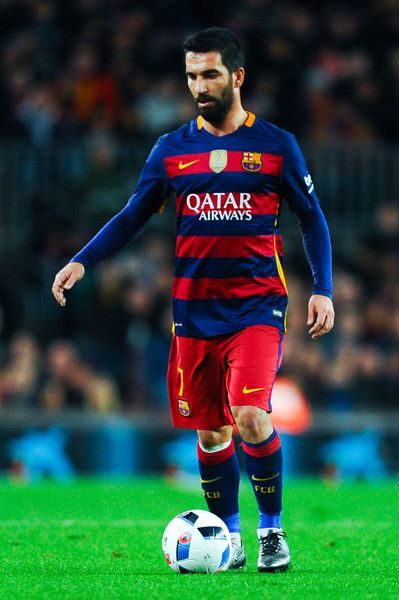 Arda Turan of FC Barcelona runs with the ball during the Copa del Rey Round of 16 first leg match between FC Barcelona and RCD Espanyol at Camp Nou on January 6, 2016 in Barcelona, Catalonia.