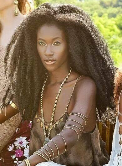 The model is from Sierra Leone, she is of the Madingo ethnic group, her name is Sarran Lan Jabbie by della