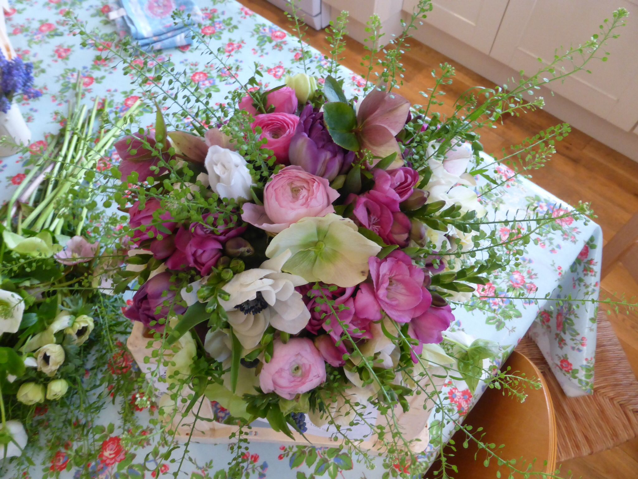 Bridal bouquet with anemones freesias ranunculus