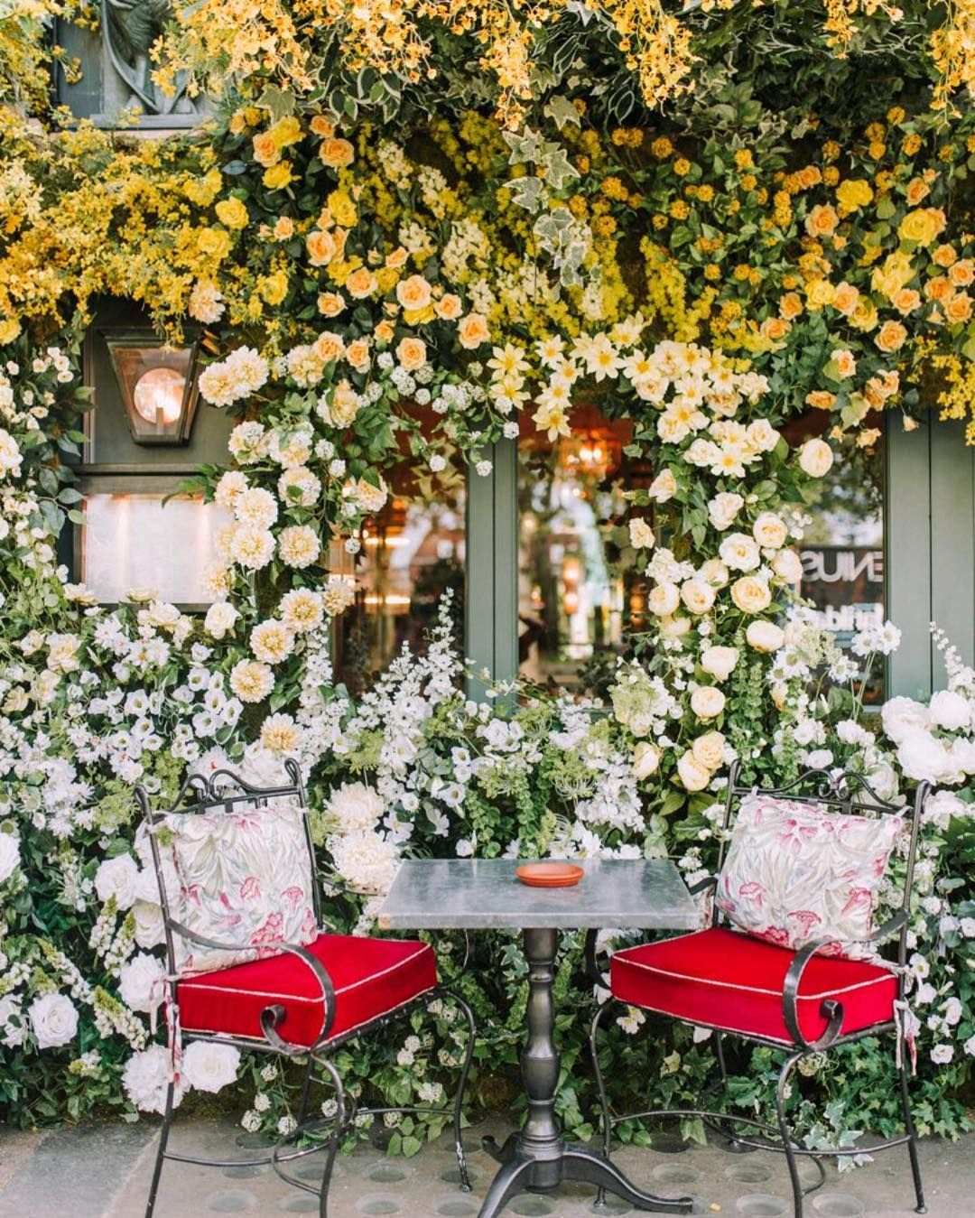 Yellow ombré of summer flowers with matching floral awning