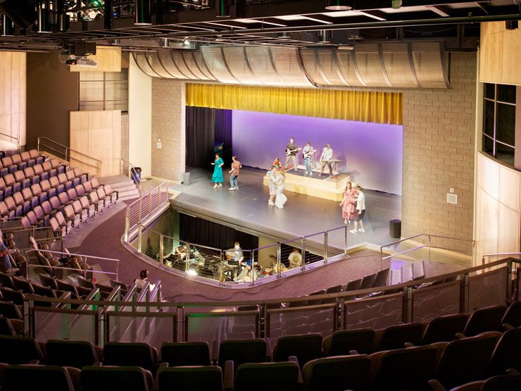 Lynnwood High School: A state of the art thrust stage theater in the arts wing is optimized for performance and collaboration. Bassetti Architects, 2009.