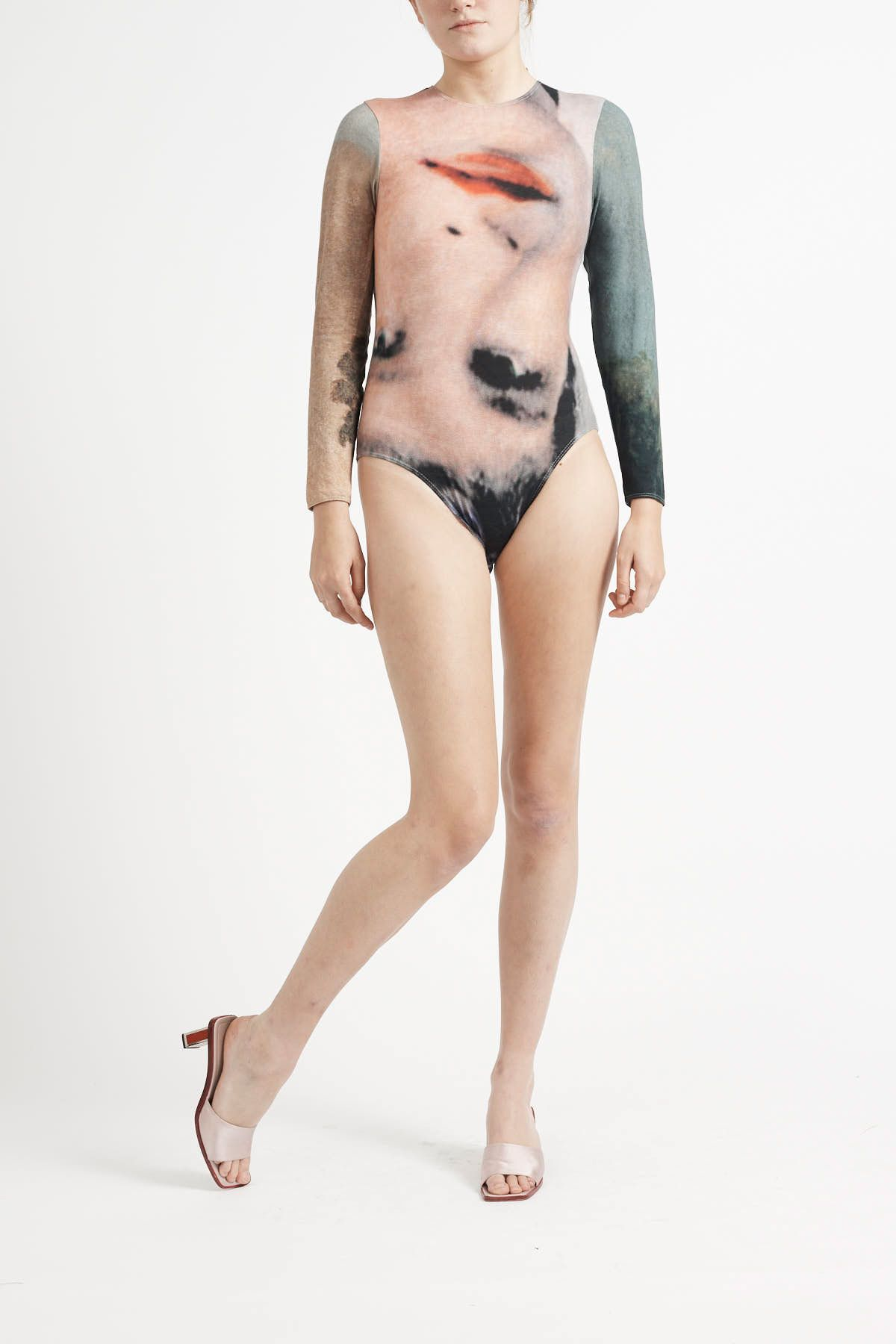 Light,digitally printed fabric with a barely there feel,stretch neckline &cuffs and ...