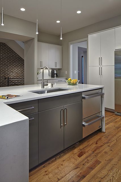 The L Shaped Island Of This Modern Kitchen Features A Zero