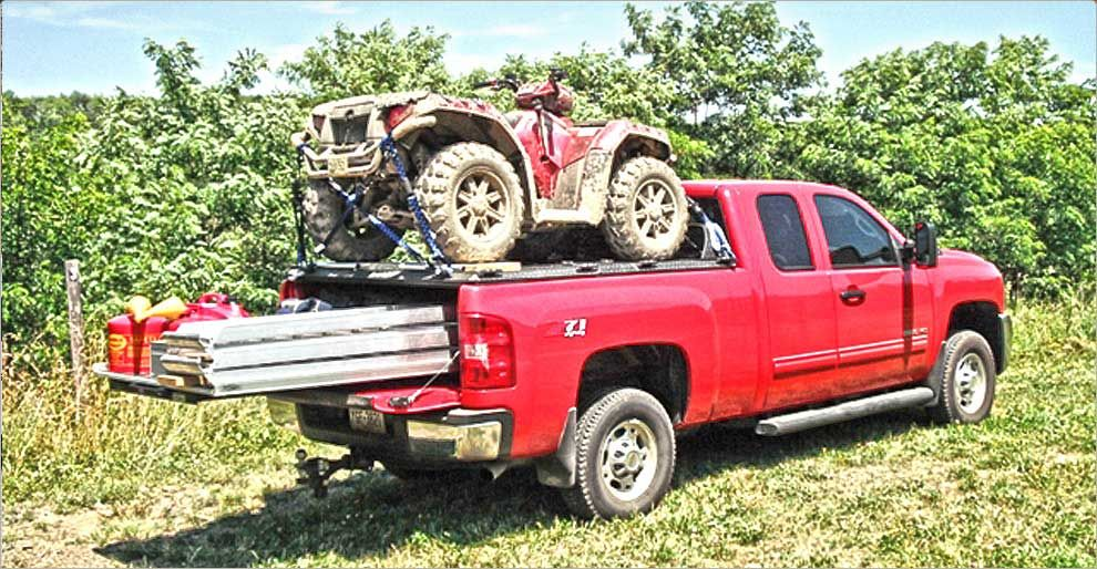 Red ATV on rearloading DiamondBack ATV Carrier on red