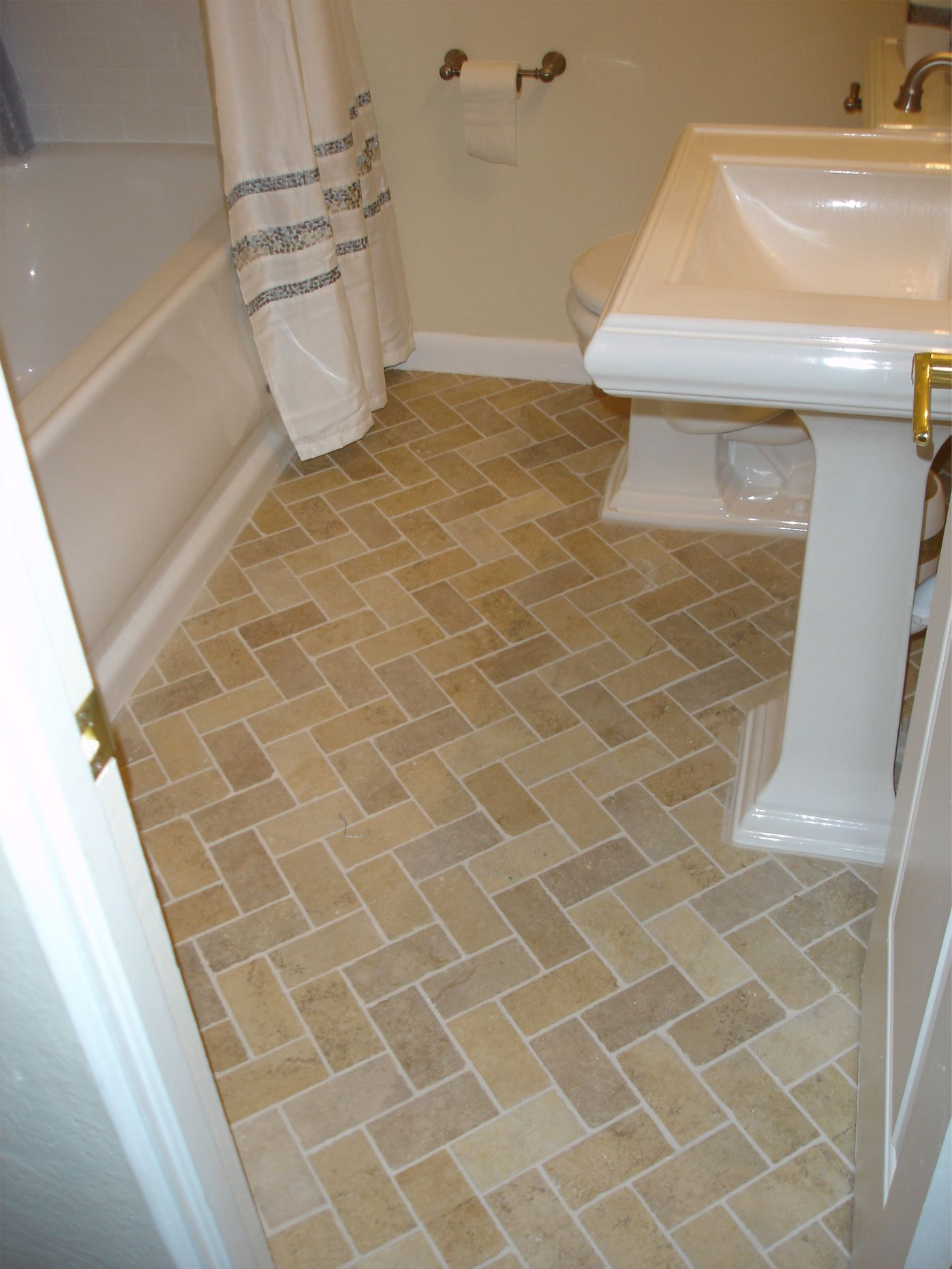 3 6 Inch Porcelain Tile Installed With A Herringbone Pattern In Bathroom Home Bathroom Tiles