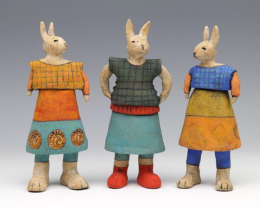 I love her work! ceramic figure with animals by Sara Swink
