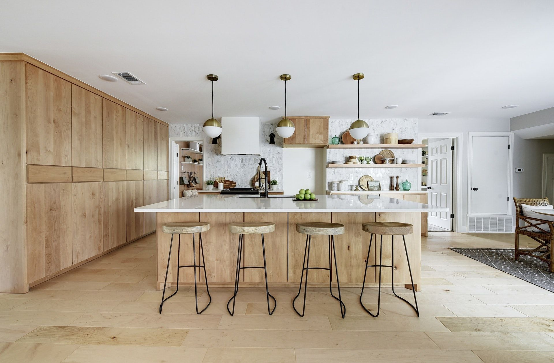 Open Kitchen With Flat Front Natural Alder Wood Cabinets Light Wood Floors Globe Pendants With White Glass And Brass Rustic Kitchen Kitchen Design Interior