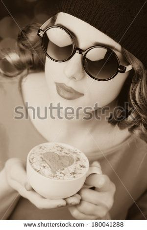 girl in glasses with cup of coffee. Photo in old color image style.