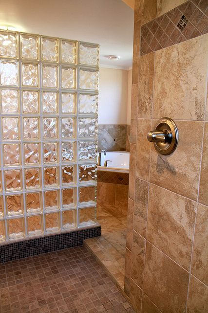 Natural stone look porcelain tile master bathroom with large walk-in European shower