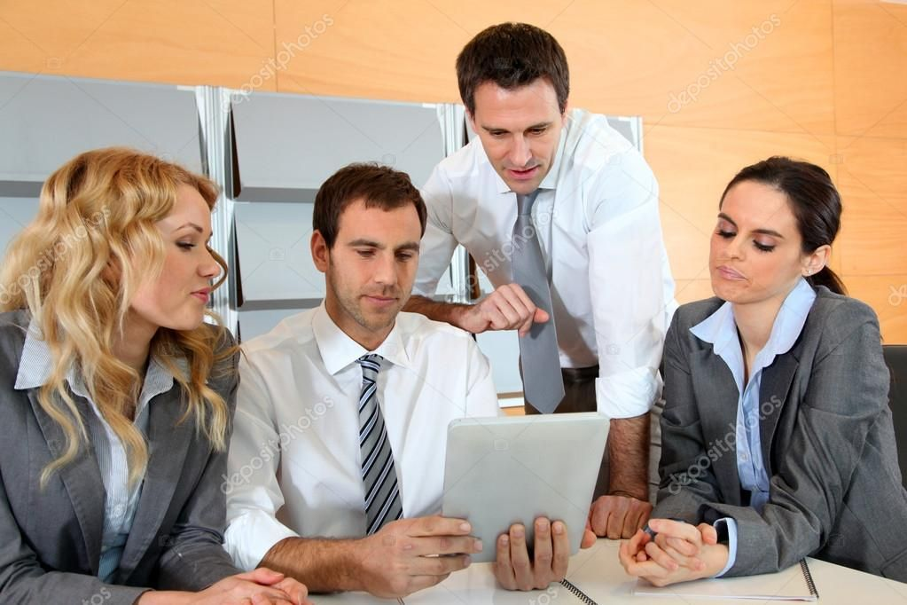 Business Meeting In Office With Electronic Tablet Royalty Free