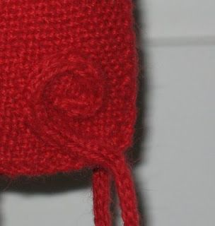Cute way to sew i-cords on baby hats
