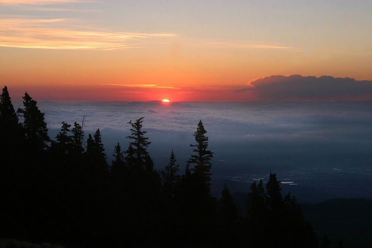 Pikes Peak, where you can watch the sun rise over the clouds.