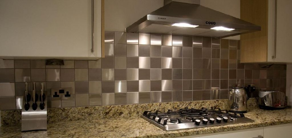 Kitchen Interior Modern Kitchen Decoration Featuring Stainless Steel Squared Tile Backsplash And Yellow Patterned Marble