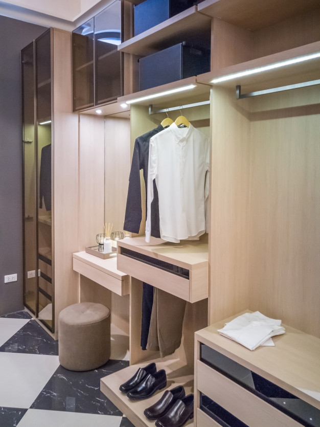 Modern Wooden Wardrobe With Clothes Hanging On Rail In Walk In Closet Design Interior In 2020 Wooden Wardrobe Closet Design Modern Closet