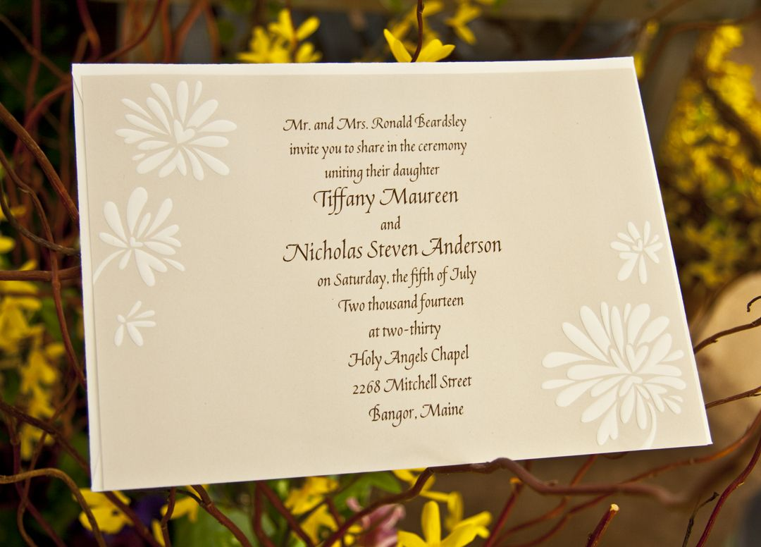 This recycled invitation features adorable white flower bursts with ...