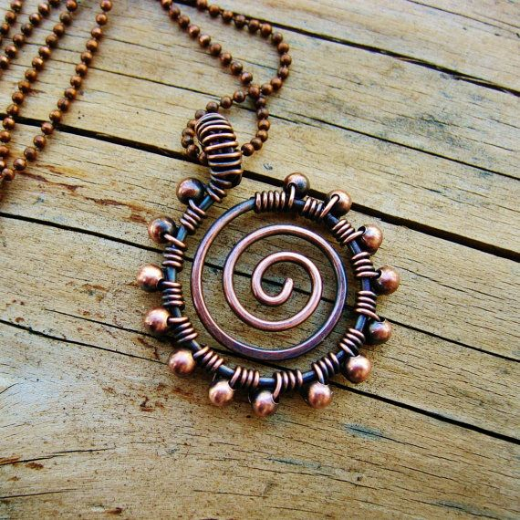 This is a great casual necklace that could be worn every day, either by itself or layered with your other favorites. Antiqued copper open swirl