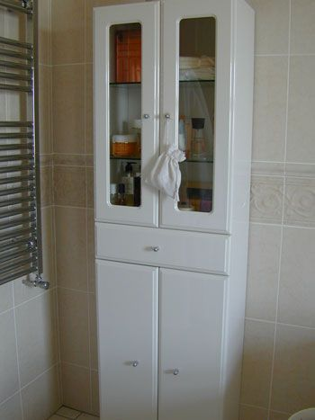 A simple wall cabinet can fit even into the smallest bathroom - if