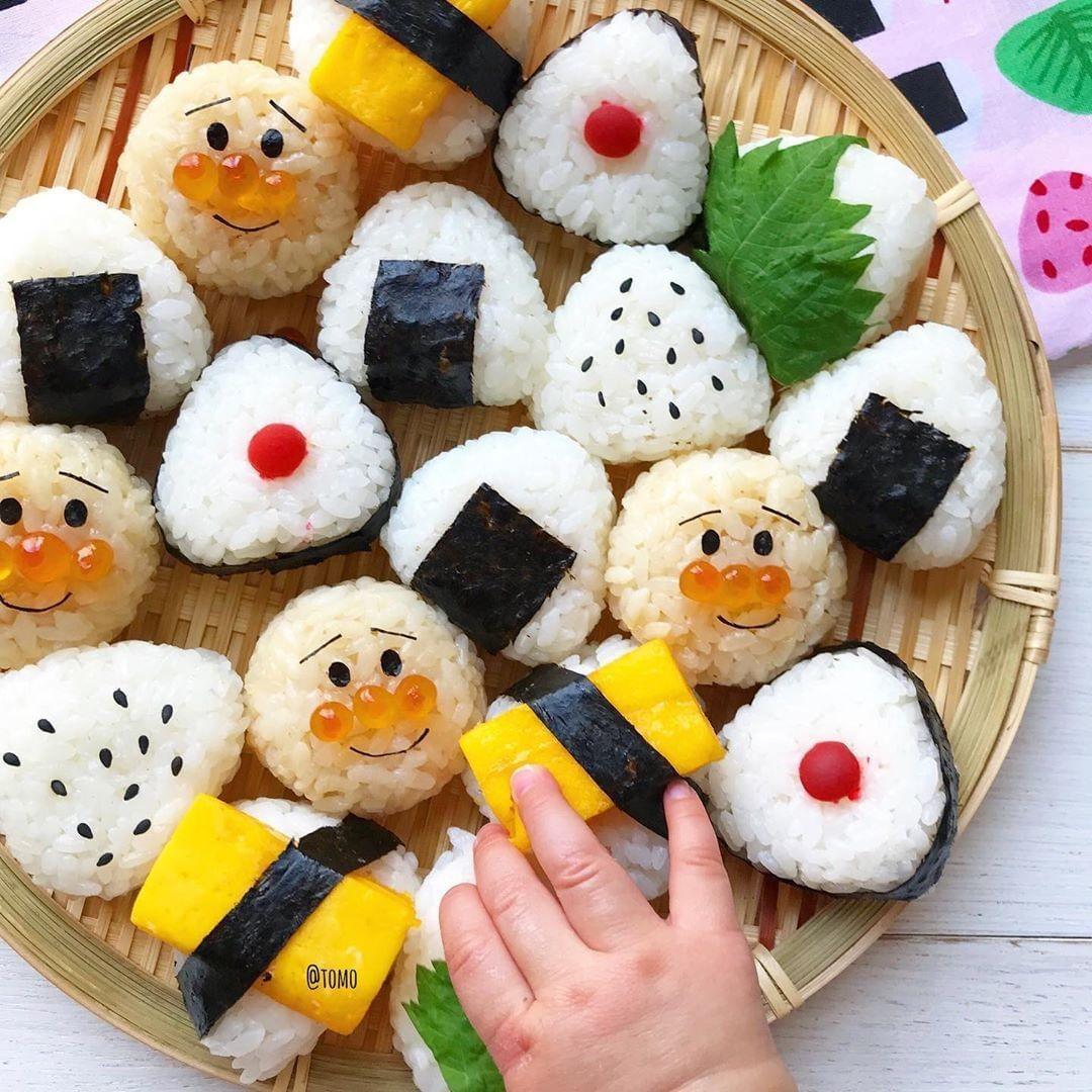 Onigiri is a triangular or cylindrical Japanese rice dish ...