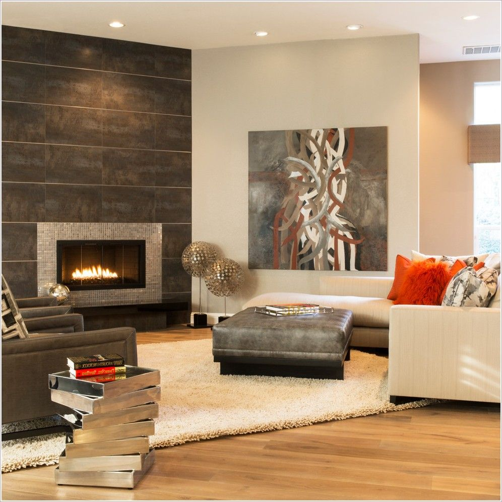 Sacramento artwork chaise sectional gray ottoman metal panels modern fireplace raised firebox shag rug stacked side table stainless steel tile table ottoman tile fireplace surround