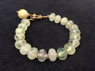 DROP DEAD GORGEOUS RUTILATED QUARTZ BEADED BRACELET WITH TOGGLE CLASP AND JADE CHARM. BEAUTIFUL THREADS CONTAINED WITHIN THE BEADS. EXCELLENT CONDITION.