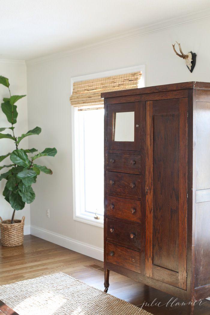 repurposing an old wardrobe as a linen cabinet