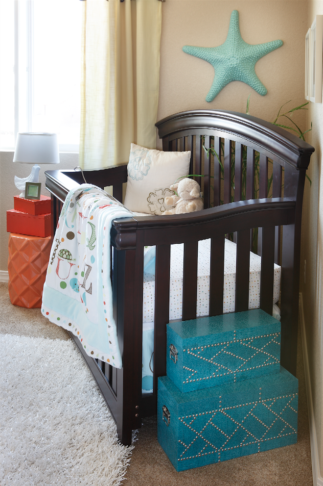 A touch of teal gets it right in this nursery with the Jamison Crib and Toddler Rail front and center.
