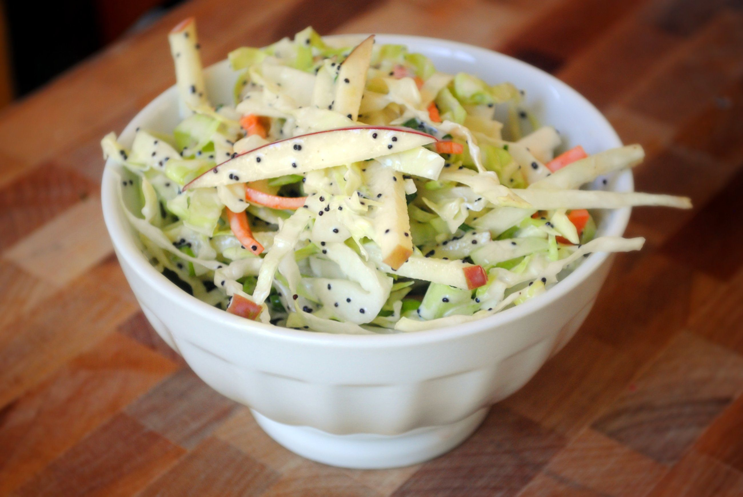 Apple cabbage slaw with creamy poppy seed dressing