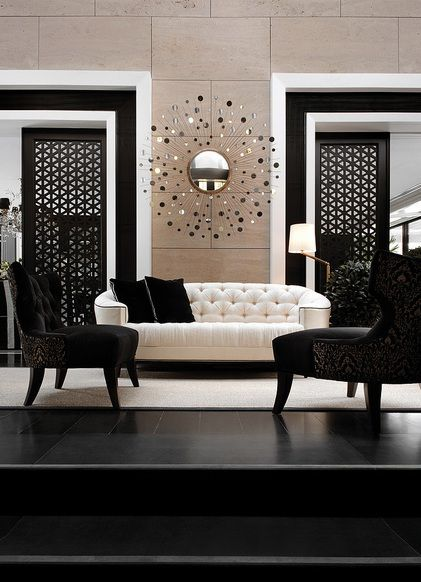 Black and white interior, sliding doors and a sunburst mirror
