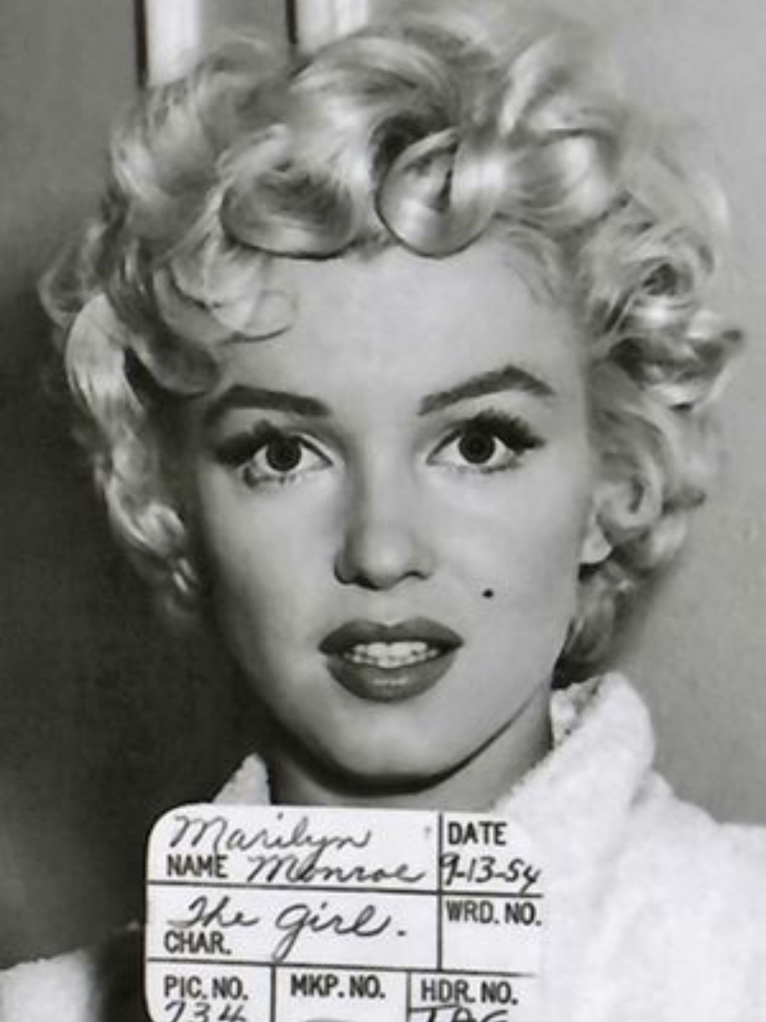 "marilyn monroe, ""the girl,"" pincurled and winsome 