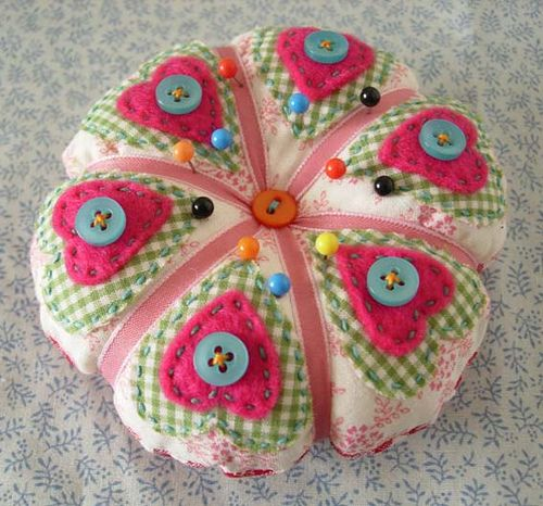 pretty pin cushion with small hearts  in two colors.