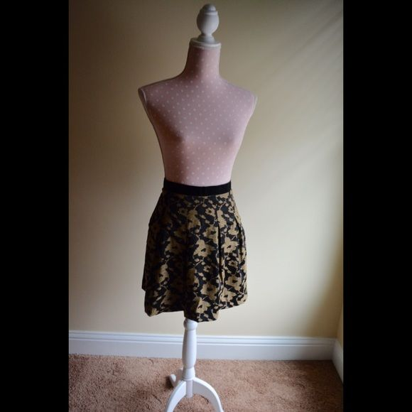 LOFT Patterned Skirt Beautiful gold and black pattern. Falls about two inches above the knee on a petite girl. Brand new!! Make an offer. LOFT Skirts