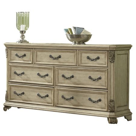 Seven-drawer dresser with scrolled leaf details.    Product: Dresser    Construction Material: Wood and metal    ...