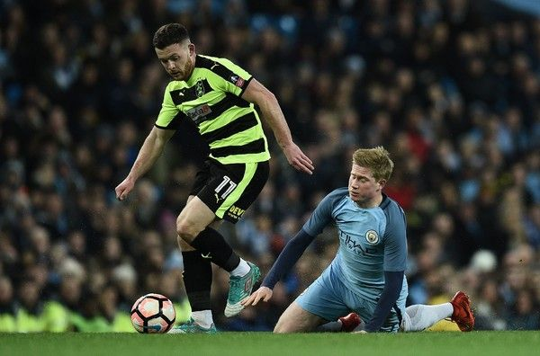 March 1st. 2017: Harry Bunn (L) beats Manchester City's Belgian midfielder Kevin De Bruyne during the FA Cup fourth round replay Huddersfield Town at the Etihad Stadium