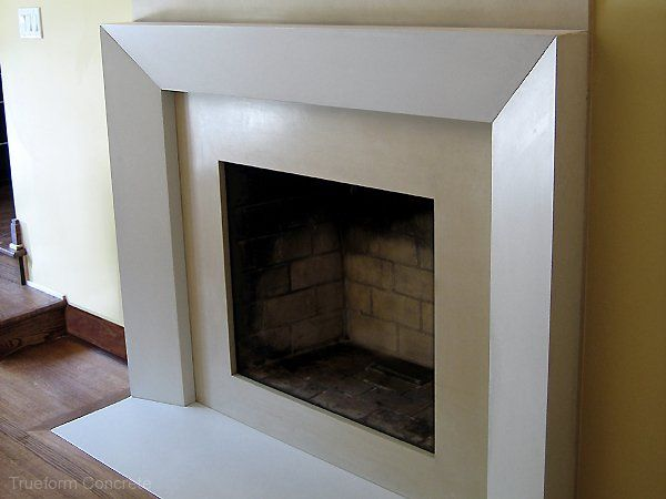 White concrete fireplace surround and hearth for a wood for Concrete mantels and hearths
