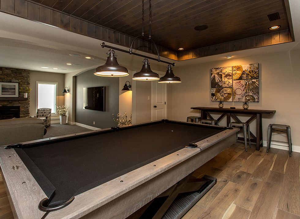 Dynasty partners custom game room adjacent to lower level for Small pool table room ideas