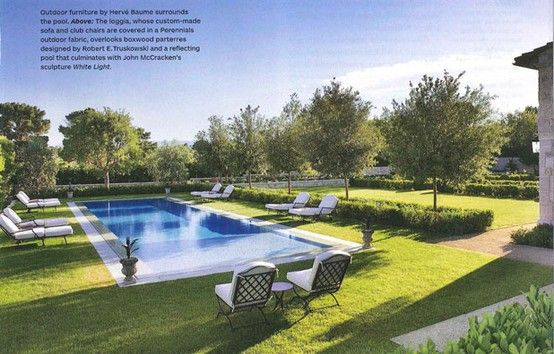 outdoor swimming pool with grass surround and semi