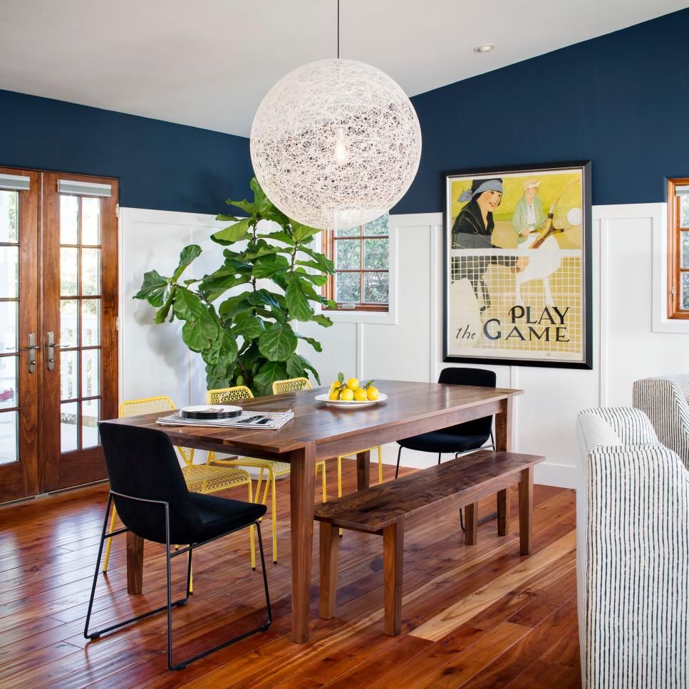 Extra high board and batten paneling pairs with a navy blue wall to ...