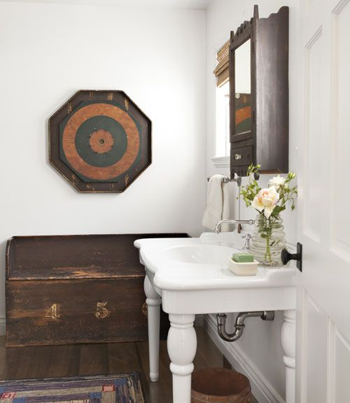 We love the look of this sink by Porcher, mixed with rustic antiques.