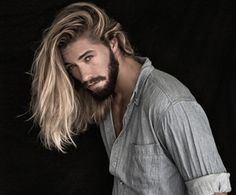 High Contrast Long Blonde Hair And Dark Beard Striking Long