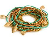 Gold and Turquoise Leatherb Wrap Bracelet- Necklace With Gold Beads and Chain. $49.00, via Etsy.