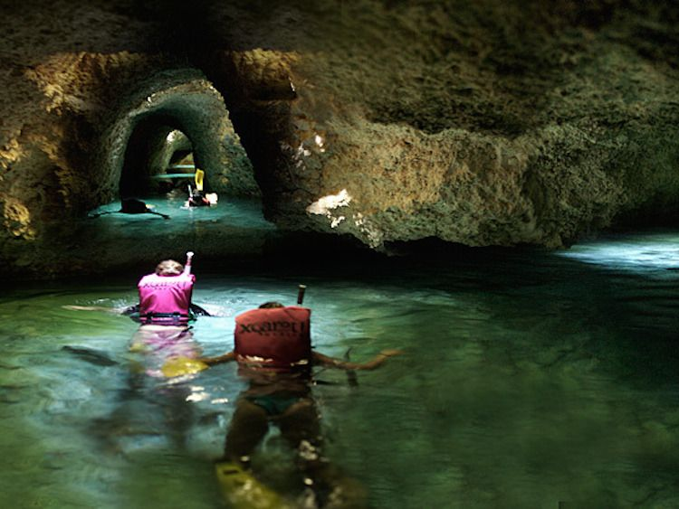 Xcaret in Cancun, Mexico -  floating on underground river currents through caves  past Mayan ruins.  Looks like a lot of fun!!